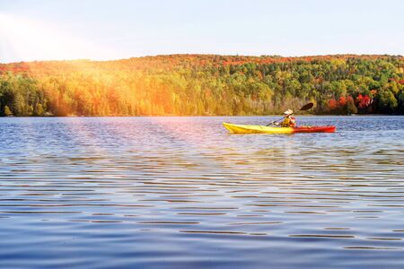 Indian summer at a lake in Algonquin Provincial Park near Toronto in autumn, Canada Stok Fotoğraf - 129320534