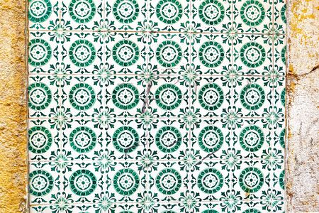 Exterior wall of a residential building with traditional portuguese tiles in the Bairro Alto district in the old town of Lisbon, Portugal Stok Fotoğraf