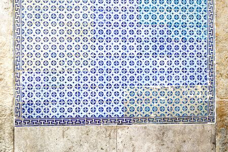 Exterior wall of a residential building with traditional portuguese tiles in the Bairro Alto district in the old town of Lisbon, Portugal Stock fotó