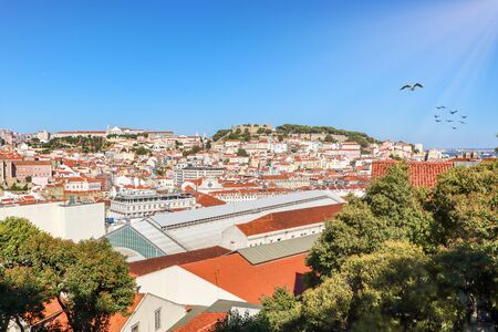 View to Alfama castle from Bairro Alto district in the historic center of Lisbon, traditional roofs in the old town, Portugal Europe Stok Fotoğraf