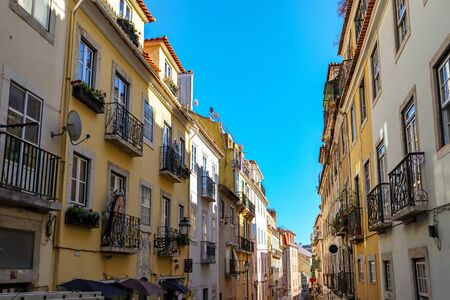 View to the Bairro Alto district in the historic center of Lisbon, traditional facades in the streets of the old town, Portugal Europe Stok Fotoğraf - 129322696
