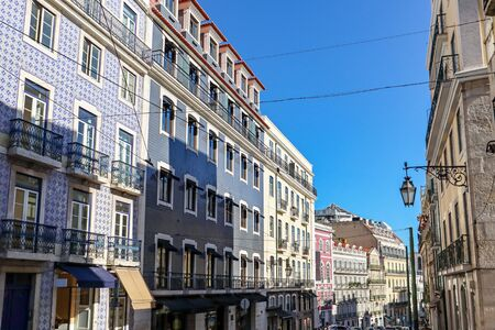 View to the Bairro Alto district in the historic center of Lisbon, traditional facades in the streets of the old town, Portugal Europe Stok Fotoğraf - 129322712