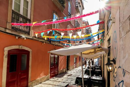 View to the Bairro Alto district in the historic center of Lisbon, traditional facades in the streets of the old town, Portugal Europe Stok Fotoğraf - 129322716