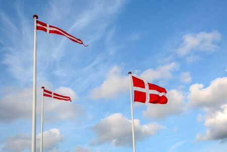 "Danish flags ""Dannebrog"" in the wind at beach near Copenhagen, National symbol for the country of Denmark 版權商用圖片"