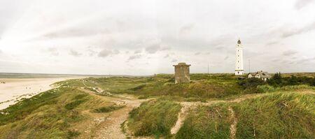 Lighthouse and bunker in the sand dunes on the beach of Blavand, Jutland Denmark Europe Standard-Bild