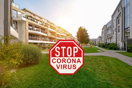 Corona Virus / Covid-19 crisis, Stay at home during quarantine, Home office in residential area with apartment buildings Standard-Bild