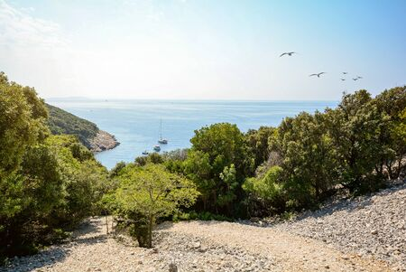 Cres Island, Istria Croatia: View to the beach and sailing boat at adriatic sea near village Valun