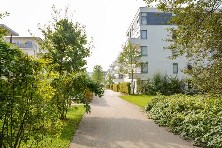 Green residential area with apartment buildings in the city, Europe