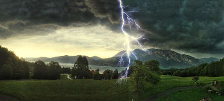 Thunderstorm with lightning strikes over the Alps at Lake Attersee, Salzburg Austria Фото со стока