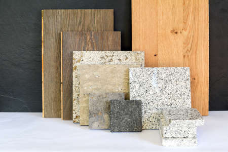 Material collage with natural stone, tiles and wooden parquet floor for renovation of an apartment building