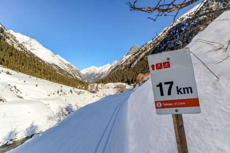Signpost at Cross-country skiing trail through the Pitztal near Sankt Leonhard in Tirol, winter sports in snowy landscape in the Austrian Alps, Austria Europe