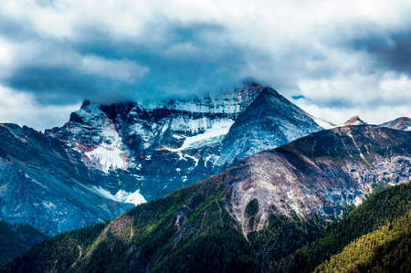 obscured: Obscured by cloud mountain Stock Photo