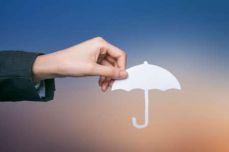 Holding umbrella Stock Photo