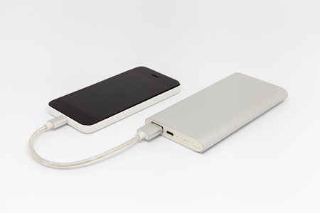 smartphone is charging from an external battery