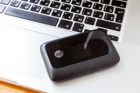4G Wi-Fi mobile router on a laptop