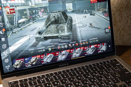 Moscow / Russia - 8 March 2021: open air macbook, world of tank blitz game on screen Editorial