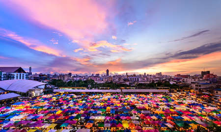 Sunset City view landscape and Colorful Market in thailand for background