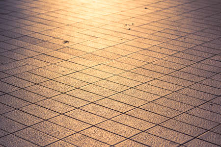 Selective focus tile roads and the rays of the setting sun