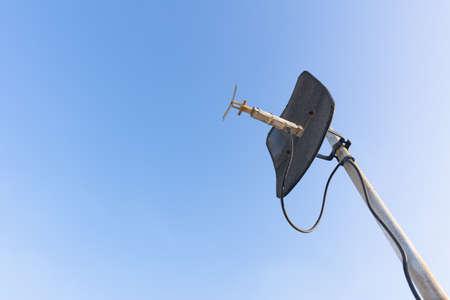 Satellite dish with blue sky. Stock Photo