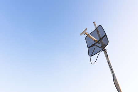 satellite dish with blue sky.