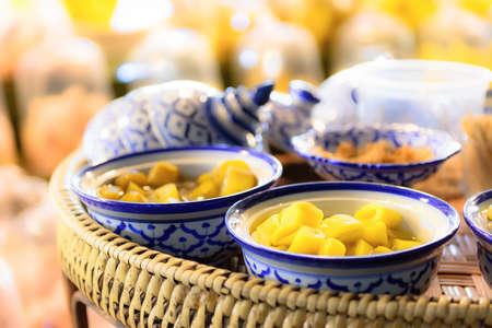 Preserved vegetables and fruits in vintage bowl