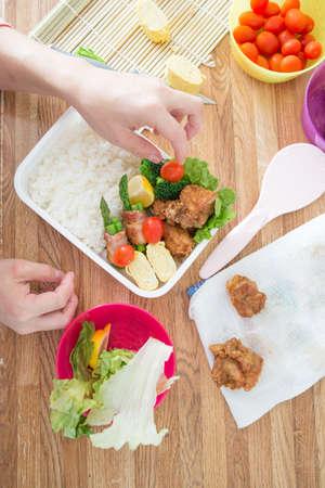 making bento, japanese style lunch box