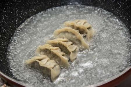 cooking gyoza