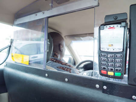 technology transaction: credit card device of taxi Stock Photo