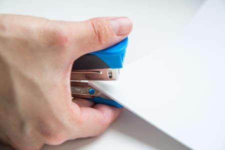 office stapler: using stapler Stock Photo