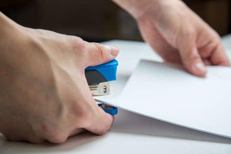 stapler: using stapler Stock Photo
