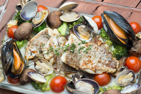 mussel: acqua pazza of red snapper Stock Photo