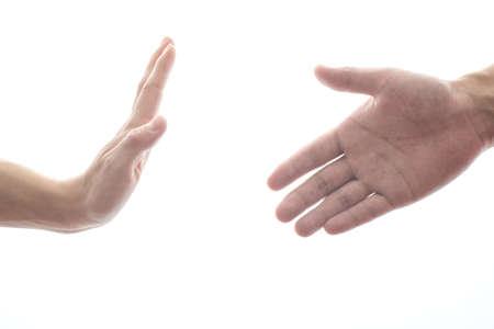 refusing: female hand refusing male hand to shake Stock Photo