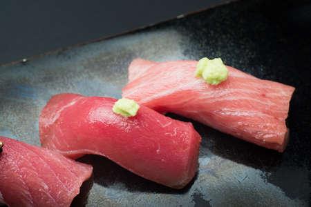three styles fatty tuna sushi, akami, chuoro, otoro, with golden leaf on