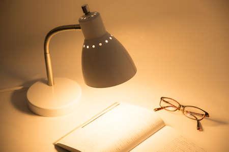 reading book under desk lump at nigjt