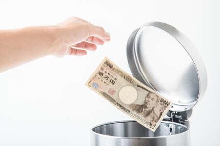 trashcan: throwing away japanese yen  in trashcan Stock Photo