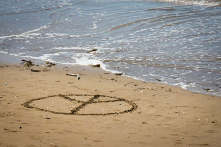 love and peace sign on beach