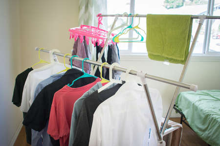 hanging washed clothes in room