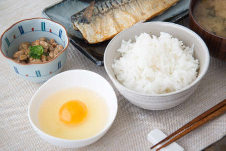 raw egg, rice and natto for japanese breakfast