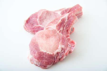 Pork loins cut in half