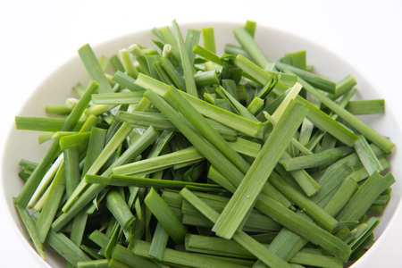 isolated chopped chinese leeks in plate