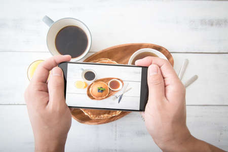 photographing pancake with phone from top