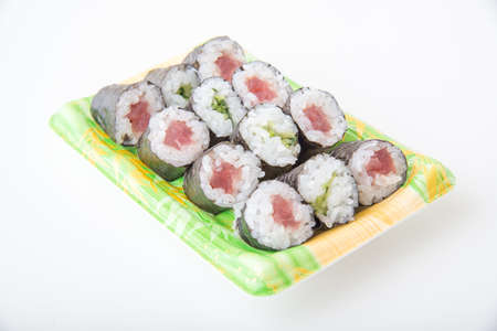 packed sushi in plastic tray