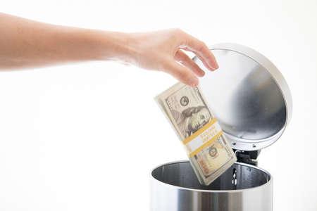 throwing away ten thousands dollars Stockfoto
