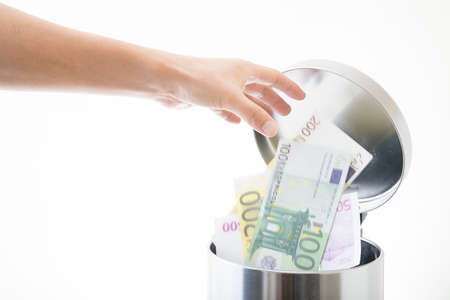 throwing away euro in waste can Stok Fotoğraf