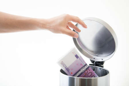 throwing away euro in waste can Stok Fotoğraf - 91699662