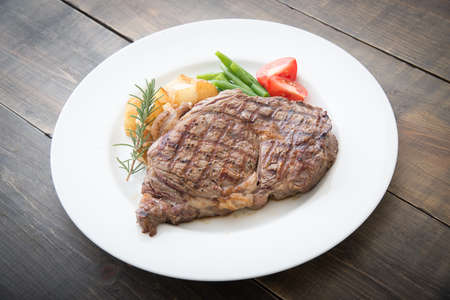 boneless rib eye steak on plate Фото со стока