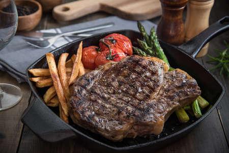grilled rib eye steak on pan Stock Photo