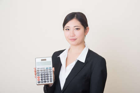 young asian woman with calculator