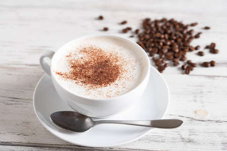 cappuccino on rustic white wood board