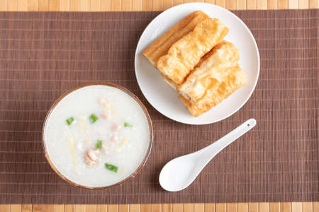 chinese chicken congee with bread stick 写真素材